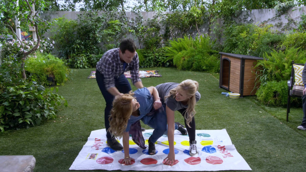 DJ fuller playing twister with Stephanie